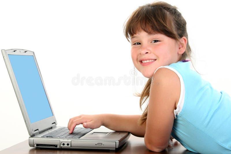 女孩膝上型计算机运作的一点 库存照片