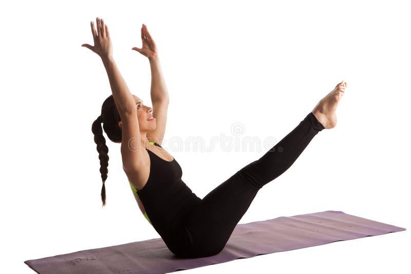 女孩舒展被隔绝的瑜伽pilates 免版税库存图片