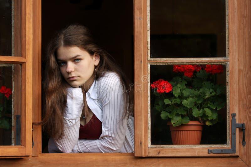 女孩视窗 免版税库存照片