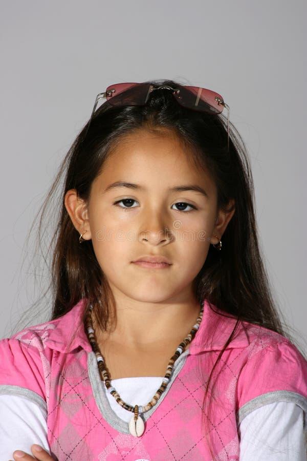 女孩讲西班牙语的美国人 图库摄影