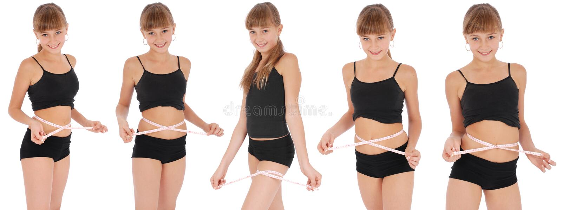 女孩评定评定的磁带腰部 免版税库存照片