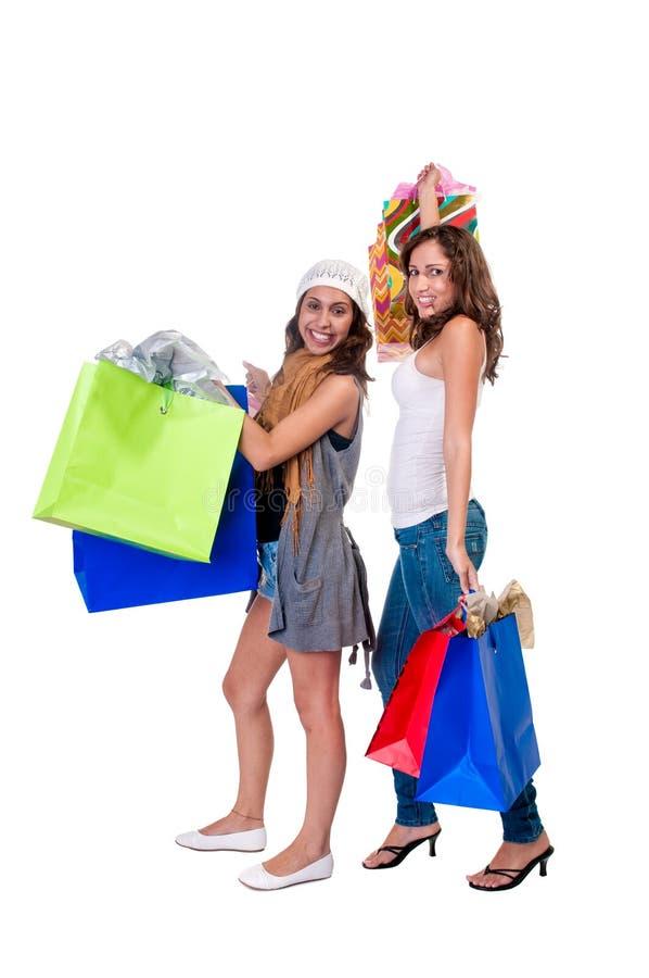 女孩购物的年轻人 免版税图库摄影