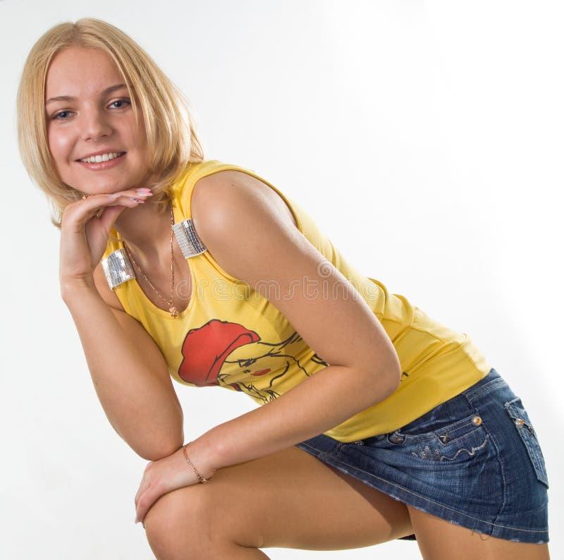 女孩超短裙年轻人 库存照片