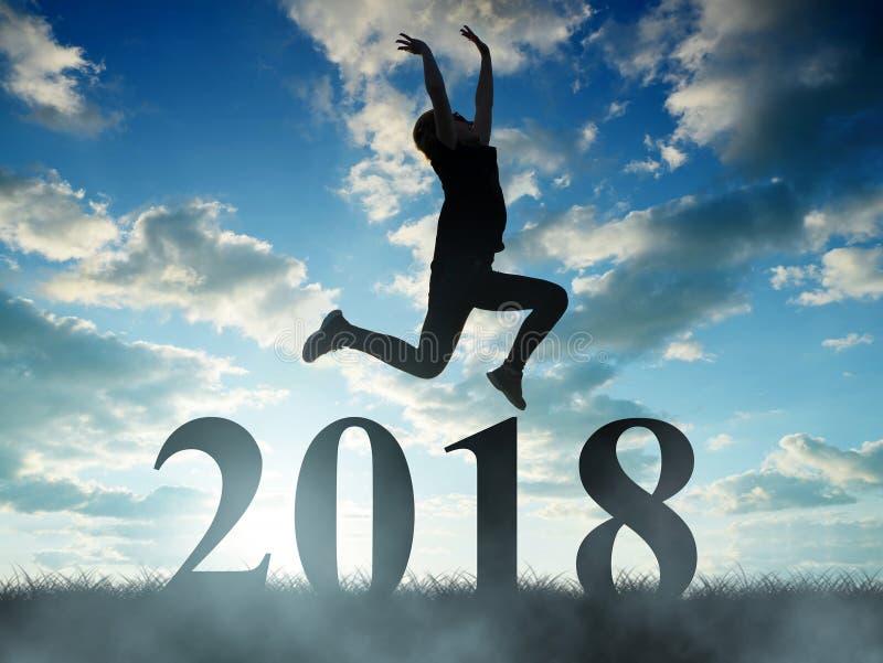 女孩跳到新年2018年 库存图片