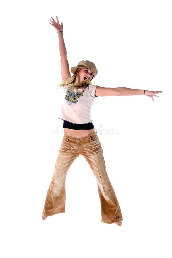 女孩跳年轻人 库存图片
