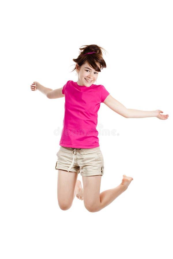 女孩跳的年轻人 免版税图库摄影