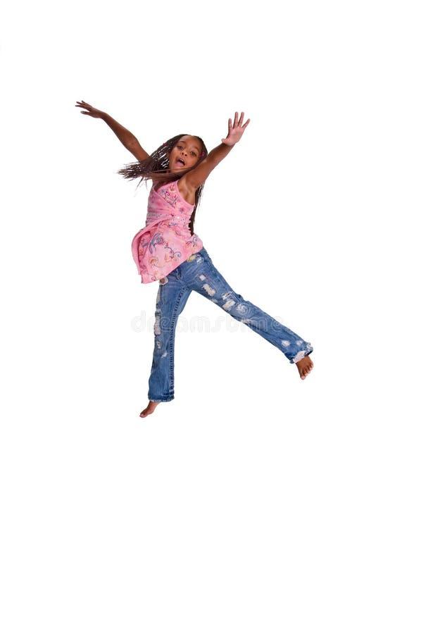 女孩跳的年轻人 免版税库存照片