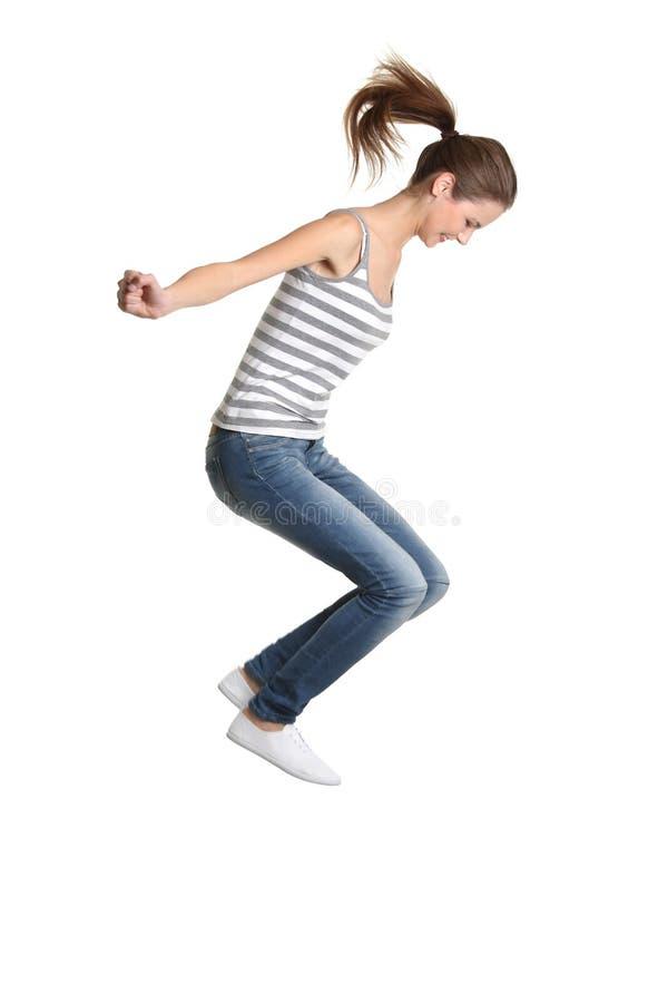 女孩跳青少年 免版税图库摄影