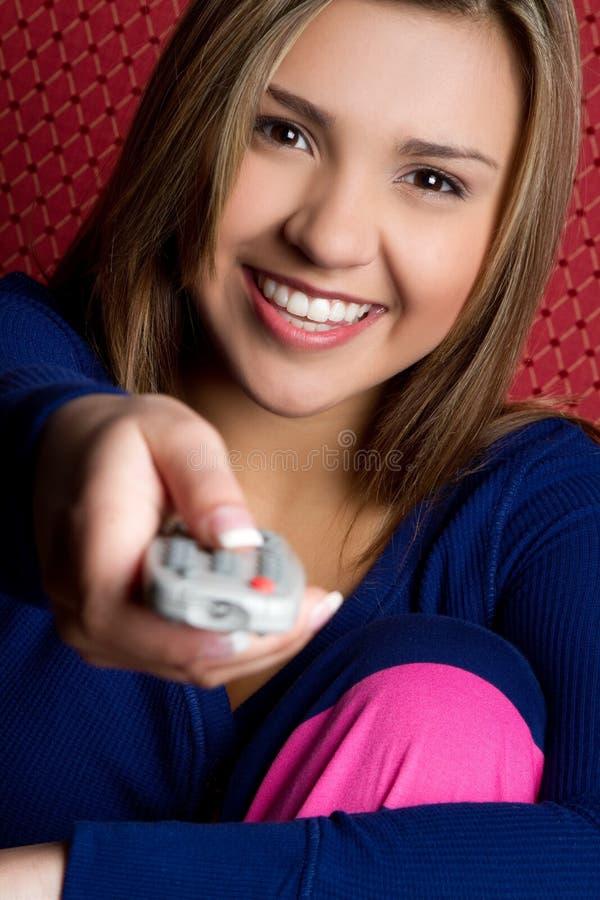 女孩远程电视 库存图片