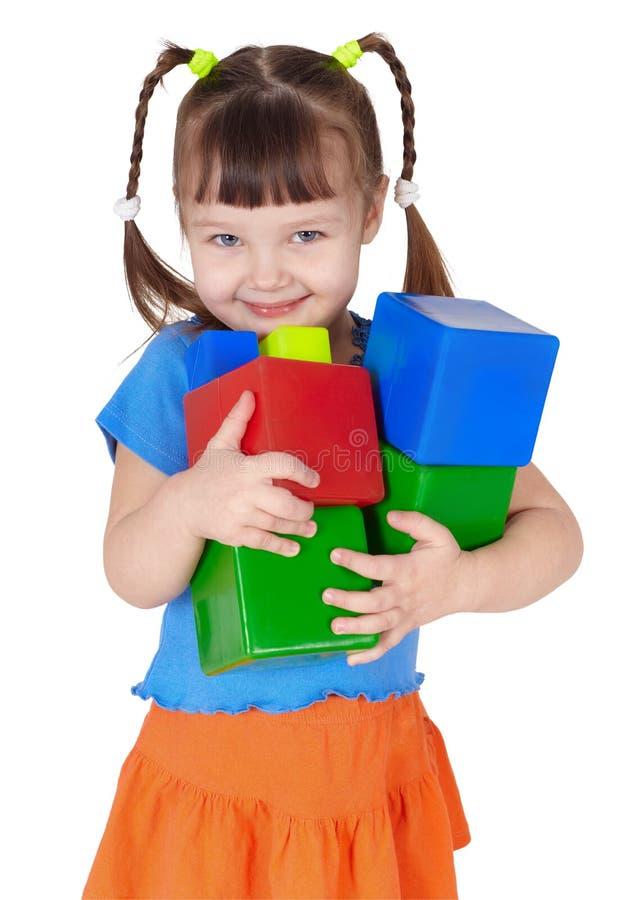女孩递愉快的小的玩具 图库摄影