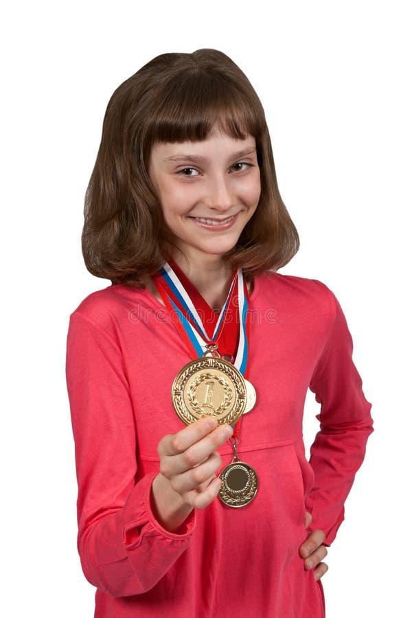 女孩金牌显示 图库摄影