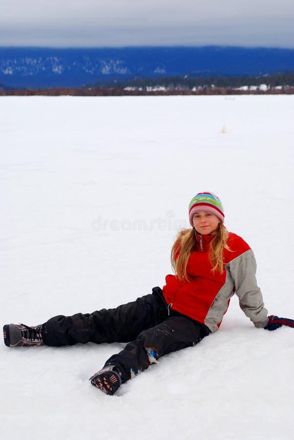 女孩雪年轻人 免版税库存照片