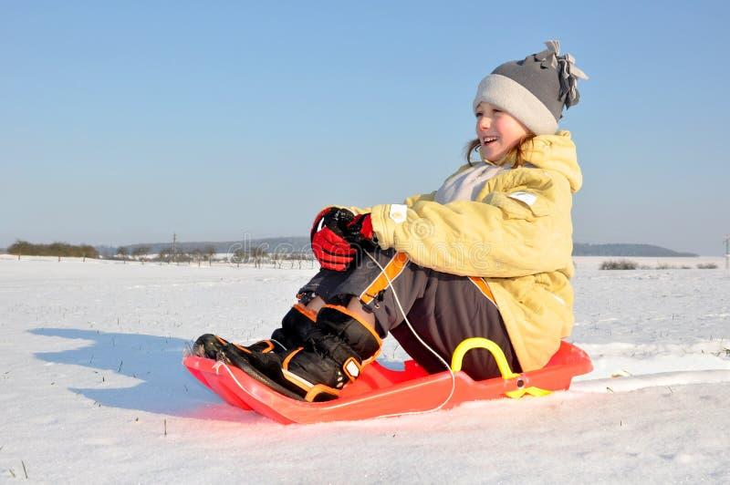 女孩雪橇 免版税库存图片