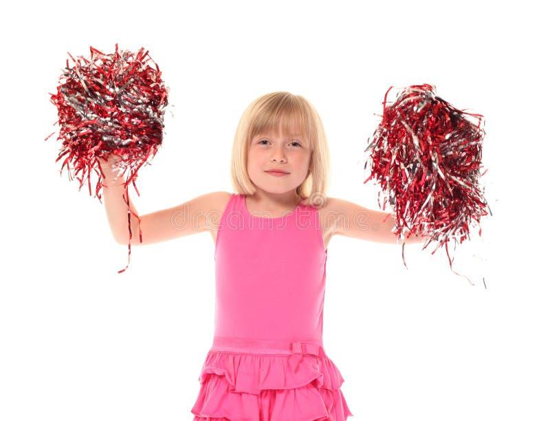 女孩震动年轻人的一点pom poms 库存图片