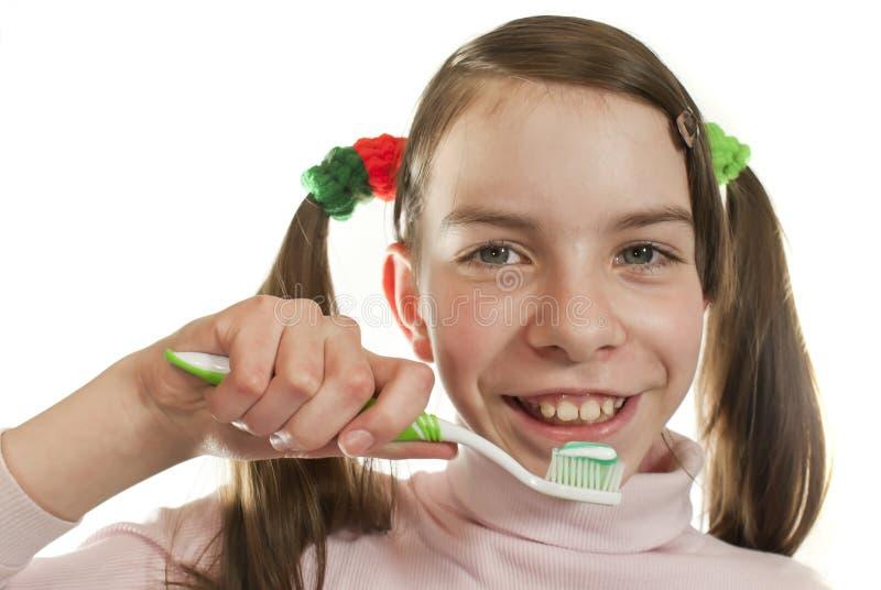 女孩青少年的牙刷 免版税图库摄影