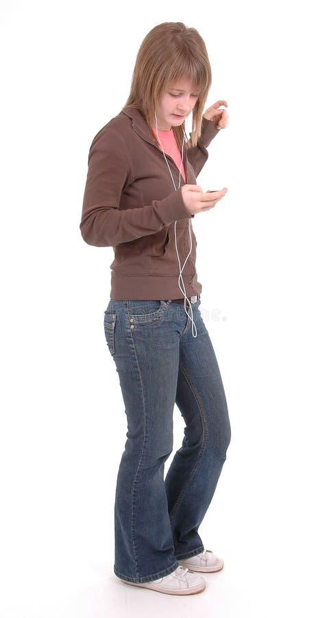 女孩青少年的MP3播放器 库存照片