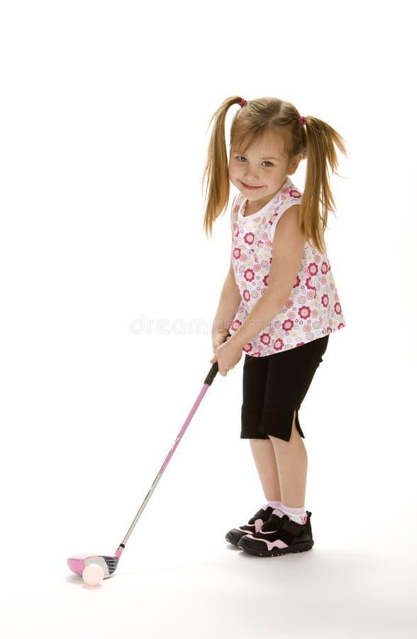 女孩高尔夫球一点 图库摄影