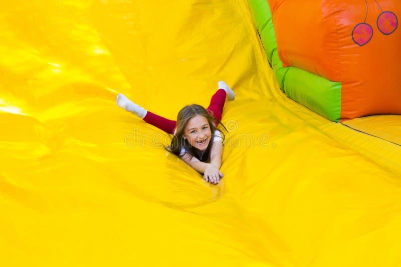 女孩滑下来 免版税库存照片