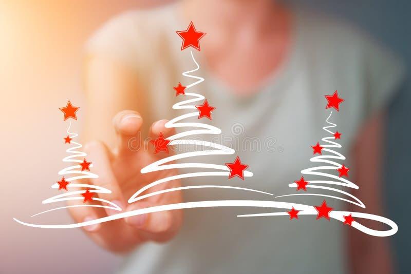 女实业家举行和感人的圣诞树剪影 皇族释放例证
