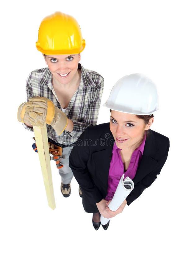 女实业家和女工匠 库存照片