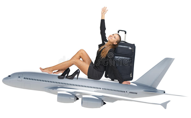 女实业家坐喷气机 库存照片