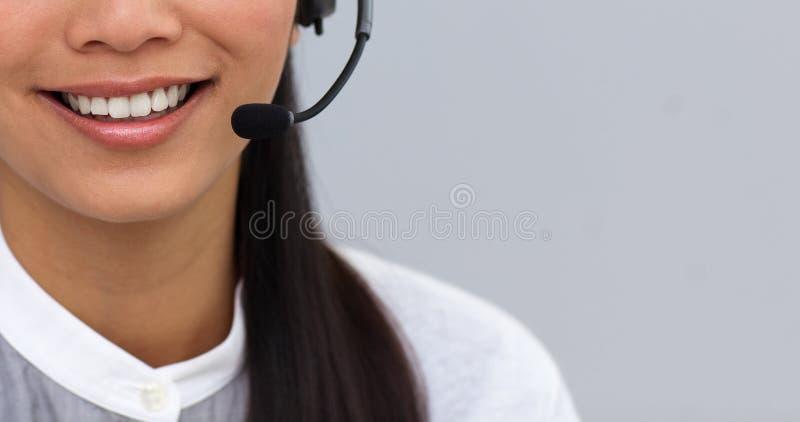 女实业家接近的耳机使用 免版税图库摄影