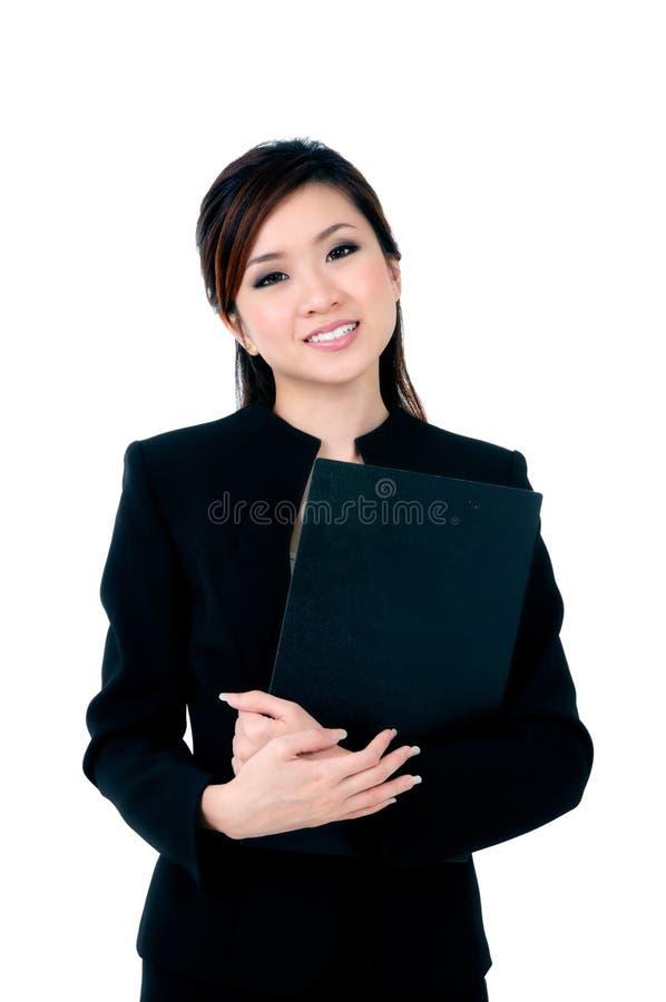 女实业家文件愉快的藏品年轻人 免版税库存图片