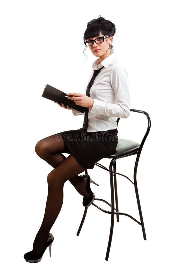 女实业家椅子文件夹现有量 免版税库存图片