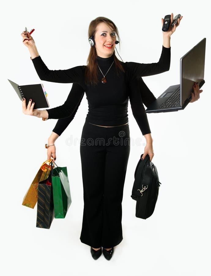 女实业家神秘模式的multitask 库存图片