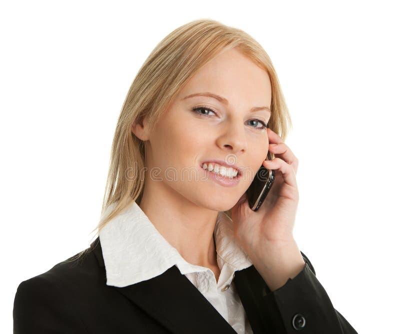 女实业家移动电话联系 免版税库存图片