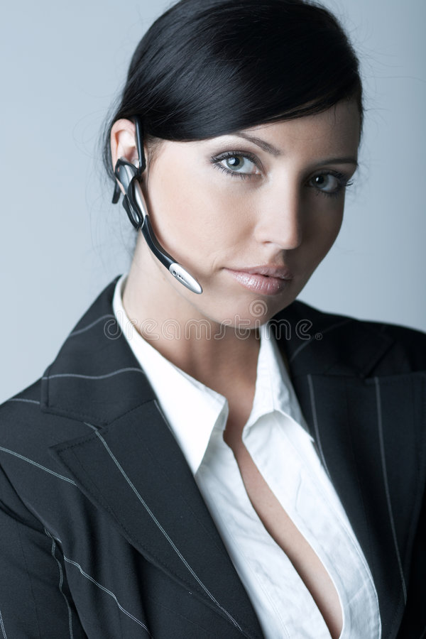 女实业家耳机 库存照片