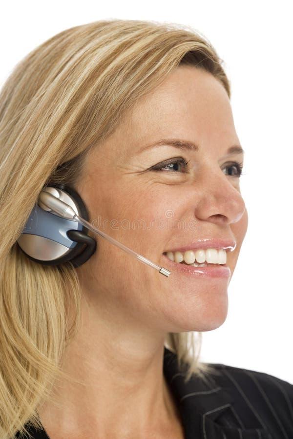 女实业家耳机 免版税库存照片