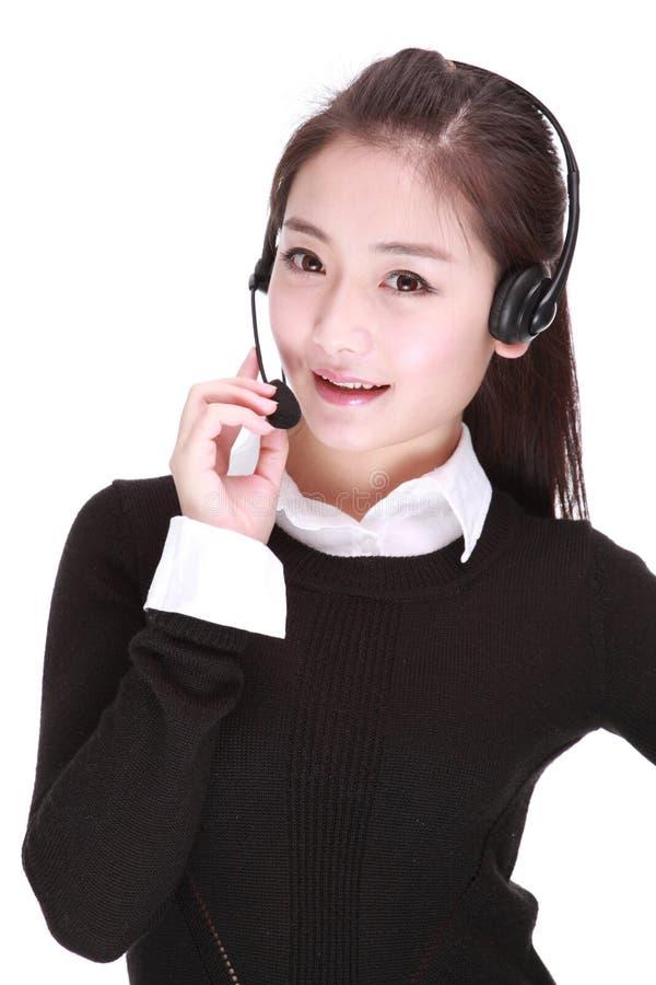 女实业家联系在耳机 免版税库存照片