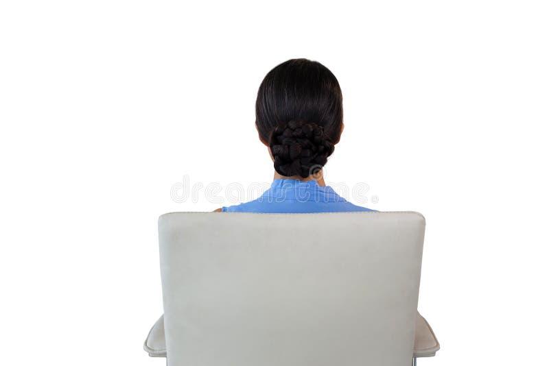 女实业家背面图坐椅子 库存照片