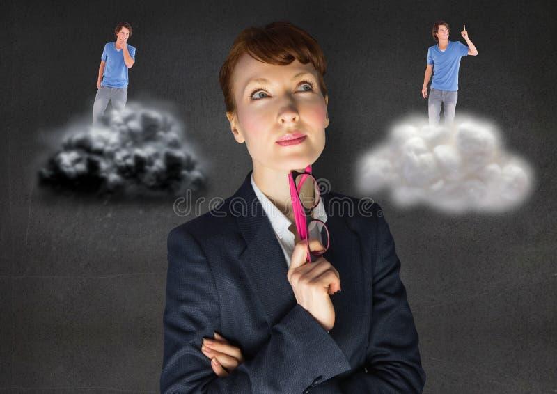 女实业家被迷惑在是之间好或坏良心 免版税库存照片