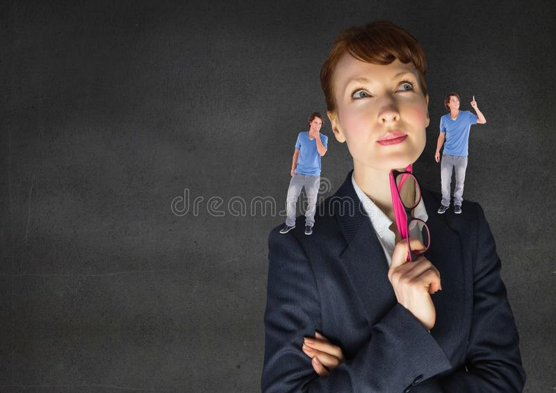 女实业家被迷惑在是之间好或坏良心 免版税库存图片