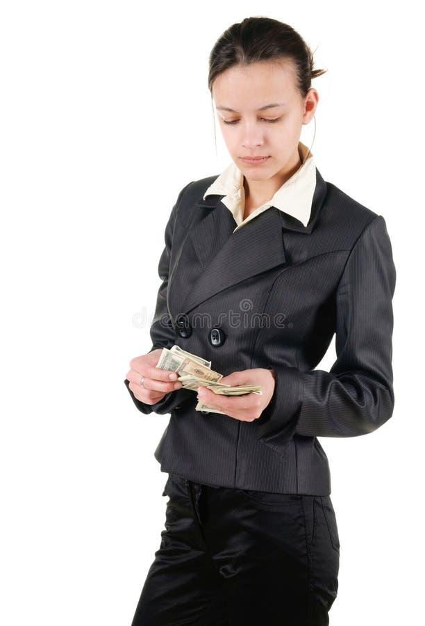 年轻女实业家计数金钱 免版税库存图片