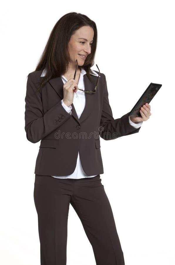 女实业家设备藏品片剂 免版税库存图片
