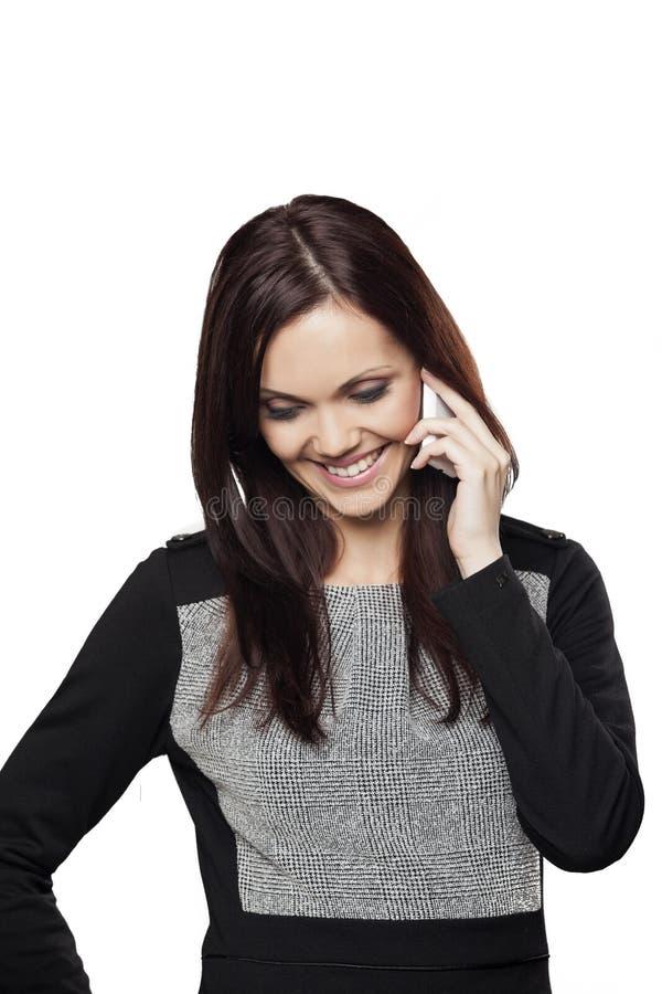 女实业家谈话在手机 免版税库存照片