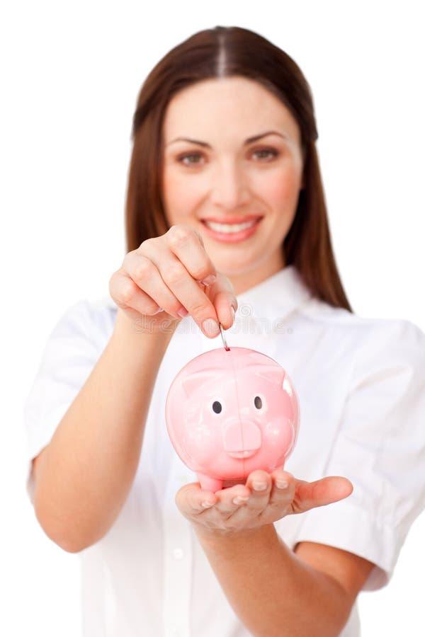 女实业家货币piggybank节省额年轻人 库存图片