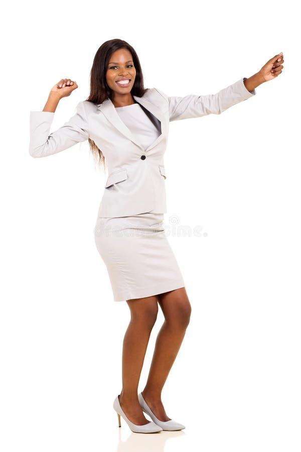 年轻女实业家跳舞 免版税库存图片
