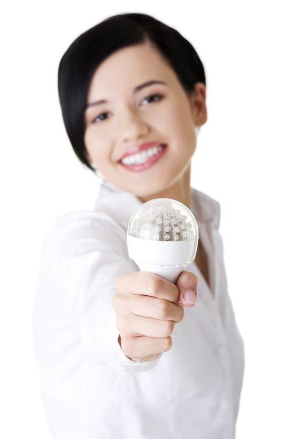 女实业家陈列导致电灯泡 免版税库存图片