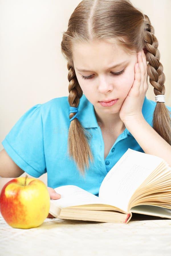 女小学生十疲乏的岁月 免版税库存照片