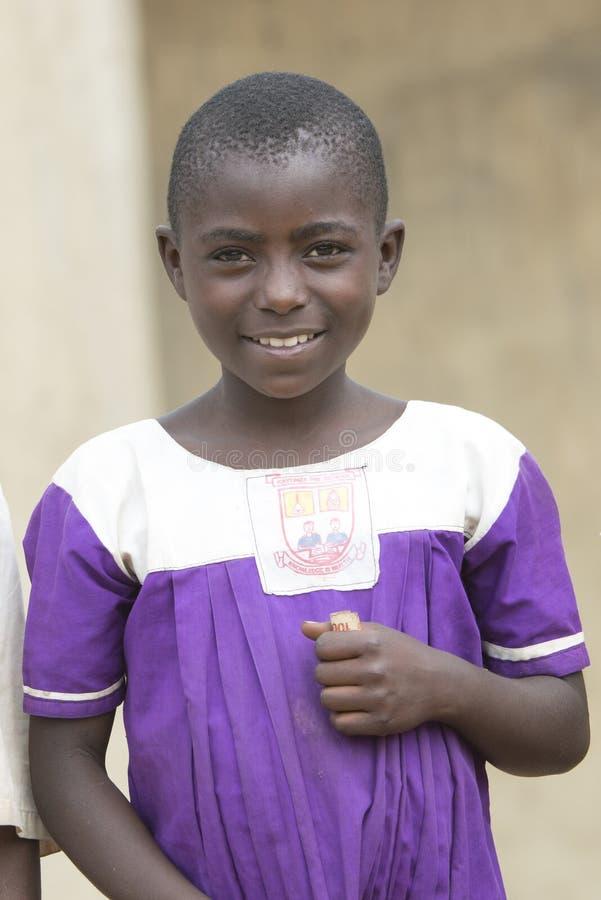 女小学生在有校服的乌干达 免版税库存图片