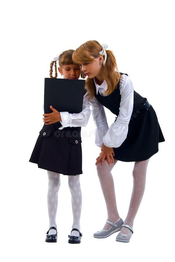 女小学生巧妙的统一 免版税库存照片