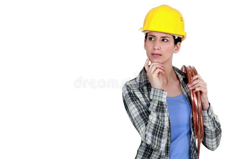 女工匠认为 免版税库存照片