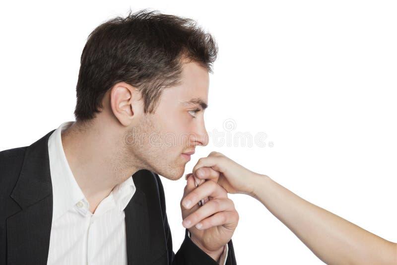 女性亲吻的专业年轻人 免版税库存图片