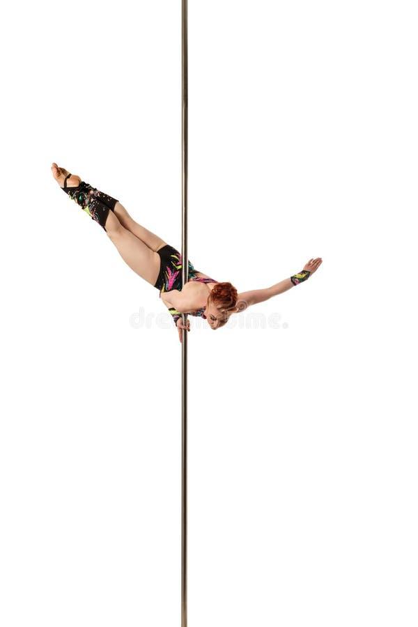女性体操运动员跳舞的图象在定向塔的 免版税库存图片
