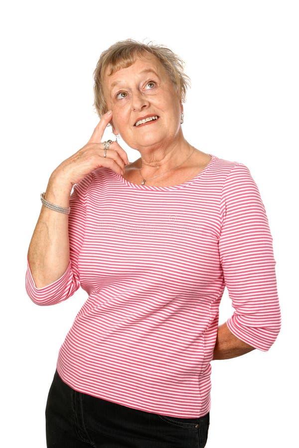 女性前额她指向的前辈 免版税库存图片