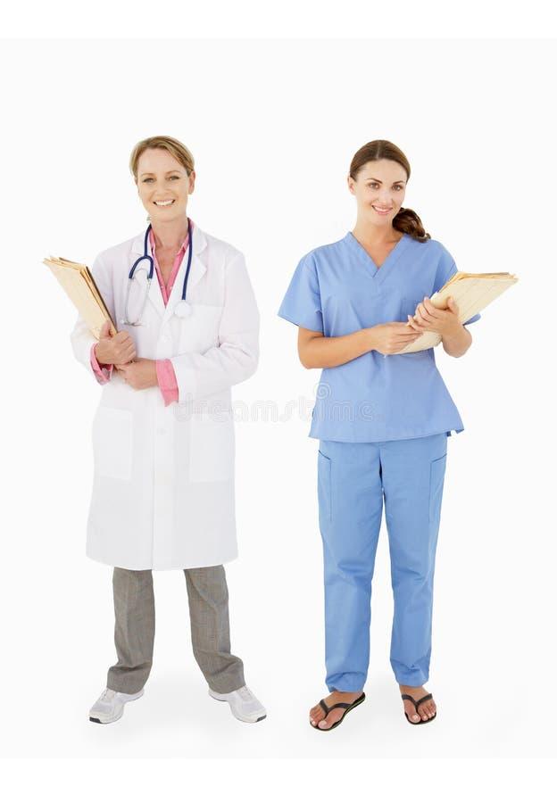 女性医疗人员纵向在工作室 库存照片
